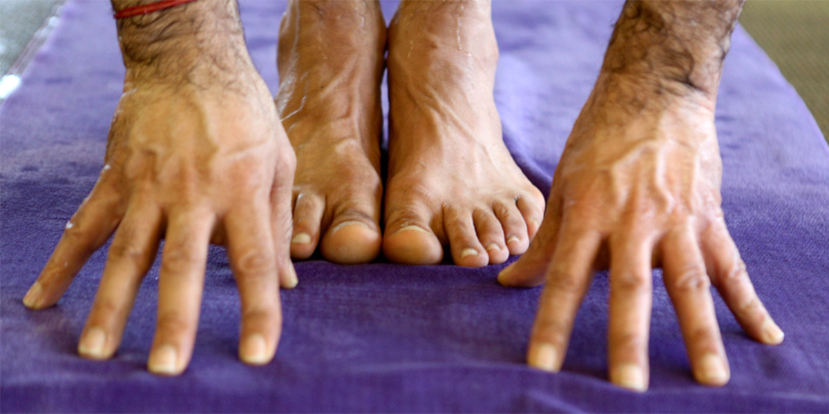 Hands and Feet on Purple Towel